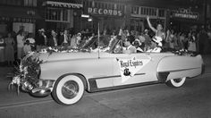 "April 1950, a woman and four men in parade car with banner reading ""Royal Esquires."" Credit MOHAI, Al Smith Collection, 2014.49"