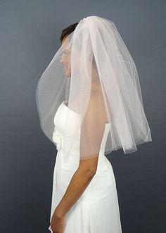 Beautiful blush wedding veil with two layers in a wide width. This bridal veil is a great choice to enhance the look of a blush tone wedding dress. It is made of soft tulle and is elbow length at 30/30 in length and 108 wide on a flexible wire metal comb. Blush only. Made to order. Allow 3 weeks delivery.  DETAILS: * Wedding Veil, 2-Tiers * Soft Nylon Tulle * Elbow Length, 30/30L (108W) * Flexible Wire Metal Comb * Blush  SWATCHES: *** Love this look? Seriously interested in this ve...