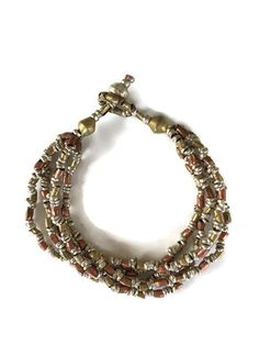 Unique and beautiful! This bracelet will match everything, as it's made from three different metals: copper, silver, and brass. These beads are made from recycled bullet casings by women in Ethiopia, providing economic opportunity for women with HIV/AIDS or fistula.