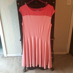 Coral princess cut dress Two shades of coral, cap sleeves, flowy skirt. Very light material and slimming. Worn once. New York & Company Dresses Midi