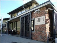 Truth Coffee arguably has the best coffee in Cape Town, brewed by expert baristas. Restaurant Door, Restaurant Exterior, Restaurant Design, Facade Design, Exterior Design, House Design, Modern Exterior, Storefront Doors, Rustic Coffee Shop