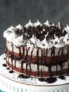 Oreo Cookies and Cream Ice Cream Cake. A brownie base, cream, cheese, chocolate, and lots of Oreos...delicious.