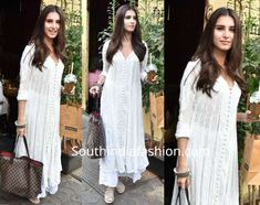 Tara Sutaria stepped out recently wearing a white chikankari kurta with matching palazzo pants. She carried a Louis Vuitton tote and finished off her look with nude makeup and silver jewelry! Chikankari Suits, Indie Mode, Dress Indian Style, Indian Wear, Bollywood Outfits, Indian Bridal Outfits, Indian Designer Suits, Fancy Blouse Designs, Kurta Designs Women