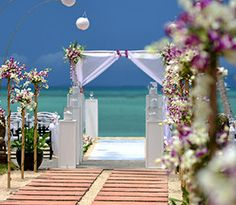 An ocean is a beautiful place to get married. Stand barefoot on the sand and be at one with the earth. Donna Merritt #wedding officiant www.thesimplewedding.com