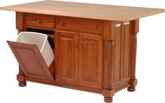 Amish Turned Leg Kitchen Island with Three Doors and Two Drawers Full of cabinet doors and spacious drawers. Includes a slide-out trash bin. Option to add mixer lift and wine rack.