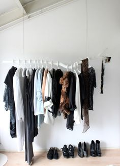 Clothes Rack made from a reclaimed tree branch. Would probably look really tacky if the hangers weren't white (or expensive wood ones).