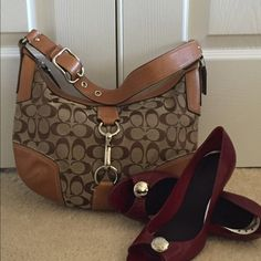 % AUTHENTIC COACH PURSE PRICE Drop. Authentic Coach hobo style purse.  In perfect condition no stains or signs of wear.  beautiful silver buckle on the strap & stitching details around leather portion. Zipper at top with small zipper bicker inside & two other open pockets.  Soooo stylish OPEN TO PRICE NEGOTIATIONS. SMOKE FREE HOME.  Coach Bags Shoulder Bags