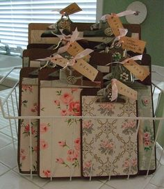 DIY::Old Clipboards...made into Shabby chic boards using old wallpaper pieces or scrapbooking papers, old jewelry & tags and  Mod Podge
