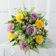 Bouquet of multicolored roses and white lilies