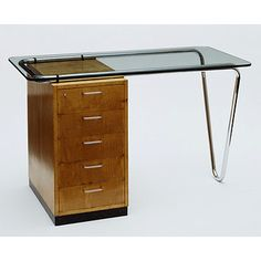 Place of origin:  Bristol (city) (made)    Date:  1935-1936 (made)    Artist/Maker:  Breuer, Marcel Lajos (designer)   P. E. Gane Ltd. (makers)   Isokon Furniture Company (manufacturers)    Materials and Techniques:  Sycamore veneered laminated board, chromium plated tubular metal, glass top, rubber fittings and linoleum