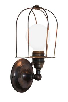 """I+love+steam-punk+fixtures,""+she+says.+Brass+caged+wall+sconce,+$900,+obsoleteinc.com   - ELLE.com"
