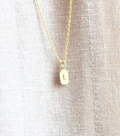 vintage brass tiny tag initial necklace. $16.00, via etsy.