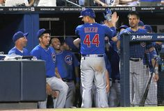 Anthony Rizzo celebrates with teammates after a solo homer in the eighth inning. 7/4/12