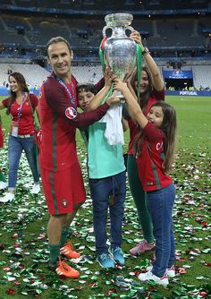 #EURO2016 Ricardo Carvalho of Portugal his wife Carina Carvalho and their children pose with the trophy following the UEFA Euro 2016 final match between...