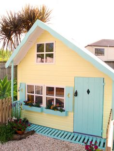 Look at how amazing this girl's pastel colored outdoor playhouse is! It's the colors of ice cream. Yellow and teal are a great combination.
