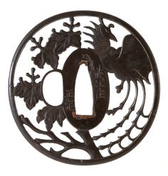 Circular tsuba, pierced and carved with a ho-ho bird (phoenix) and sprays of paulownia leaves, Bushu School, Japan, 1810-30 Bequeathed to the collection in 1903 #bmag130
