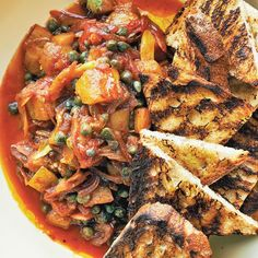 When I traveled to Sicily, I must have eaten no fewer than ten versions of eggplant caponata, and I never got sick of it! I also learned about the agrodolce—or sweet and sour—flavor profile that's so predominant in this dish, and in lots of Sicilian cuisine. My version of caponata is really flexible—serve it with crostini as a make-ahead appetizer, or even as a side dish. The addition of the briny capers, anchovies, and acidic vinegar help cure the eggplant and other veggies, so this dish…