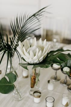 White Protea Centerpiece | Lake Forest Wedding Full of Personal Touches | Photography by Codrean Photography via Lakeshore in Love