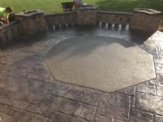 Decorative stamped concrete patio with exposed aggregate inlay.  www.fordsonconcrete.com