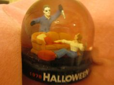 Most-wanted Halloween collectible: the Halloween snow globe, which was included with Anchor Bay's 20th Anniversary VHS release of the film back in 1998. Rather than snow, this particular snow globe was filled with drops of blood, based on the scene where Laurie and Michael duke it out in the living room. This is actually the first and only Halloween collectible to depict Laurie Strode, a character our toy collections have been missing for far too long.