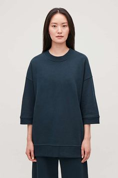 A relaxed style, this jumper is made from organic cotton and has half sleeves. Casual Going Out Outfits, Casual Dresses, Cos Tops, Cotton Jumper, Half Sleeves, Work Wear, Organic Cotton, Man Shop, Sweatshirts