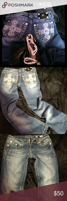 Miss Me Jeans Miss Me Jeans..super cute rhinestoned blinged silver crossed miss me jeans size 26 inseam was a 34 but was hemmed to about a 31.they are in good condition.has very small distressed areas not holes jeans are not worn out.u can see the areas in pics.they look like part of the jeans.they are in good condition.no trades no returns price firm and I only sell to trusted buyers I will cancel if I do no not feel u are a trusted buyer. Miss Me Jeans Boot Cut
