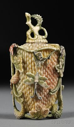 Ivory Snuff Bottle, China, 20th century, carved butterflies and insects in relief. http://www.skinnerinc.com/auctions/2584M/lots/220