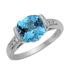 This 3.20 Carat T.W. blue topaz ring features 0.08 Carat T.W. channel set diamond accents. The high-polished mounting is crafted of genuine sterling silver.