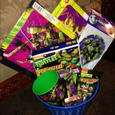 Teenage mutant ninja turtles Easter/gift basket 2 turtle 16 piece puzzles  Turtles paddle ball Turtles poo quiz grab bag Nickelodeon turtle shape puzzle 16 oz turtle cup Turtle candy apple scented shower gel Turtle grape chap stick 2 turtle washcloths Will be wrap in plastic with ribbon Other