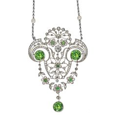 "Belle Époque Demantoid Garnet & Diamond Pendant, designed as a series of scroll and garland motifs set with two large circular-cut demantoid garnets and matching drop (the demantoid garnets weighing approximately 1.83, 1.71 and 1.70 carats, respectively), on 17"" fine link chain, with ten seed pearl stations, mounted in platinum, circa 1910."