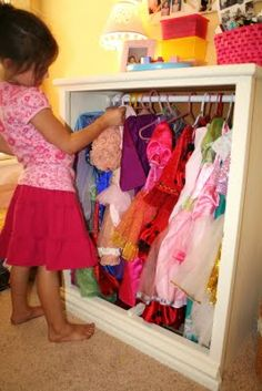 DIY Dress-Up Closet ~ Made from an old bureau with the drawers removed and a tension rod added to hang the clothes.