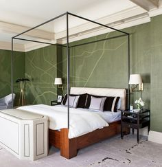 A wall covering based on a map of Washington, D.C., makes a strong statement in the master bedroom. Huntley designed the bed and the television cabinet, which is upholstered in a Rose Tarlow leather. The sconces are by Visual Comfort, and the nightstands are by Kerry Joyce for Dessin Fournir.