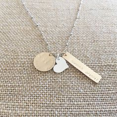 Personalized mommy charm necklace hand stamped by Classy Mama Designs.   Www.classymamadesigns.com  #family #mommyjewelry #necklace