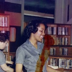 US Military bases and forts had libraries too, serving both soldiers and dependents.  Library staff at the desk assisting a soldier :: Fort Jackson Library Collection, 1970, in Columbia, SC.  Woman in background, Mrs. Richardson, was my librarian and wife of of my high school track coach.