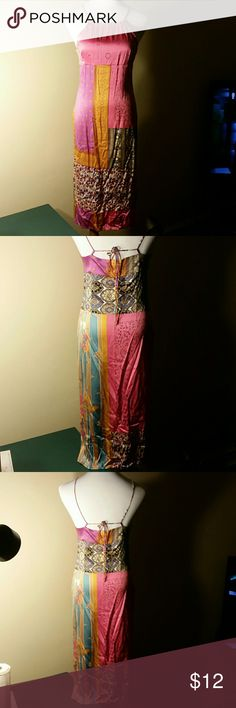 Beautiful Silk Dress Multi colored 97% silk 3% spandex dress. Some loose tread showing but no holes as shown in picture Dresses Midi