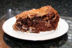 This deliciously gooey German chocolate cake is made with a cake mix, pecans, coconut, and cream cheese. The upside-down cake makes its own topping. Cake Mix Desserts, Cake Mix Recipes, Easy Desserts, Dessert Recipes, Dessert Ideas, Dinner Recipes, Upside Down German Chocolate Cake Recipe, German Chocolate Cake Mix, How To Make Cake