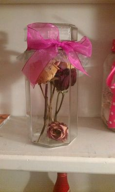 I saved a rose from every bouquet my boyfriend ever gave me, but didn't know what to do with them when I moved. I had a tall jar and some ribbon...voila!  Tip: when drying out flowers, hang upside down. I Hung mine from a shelf with tape.
