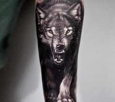 Black and grey realistic tattoo style of Wild Wolf motive done by artist Andrey Stepanov