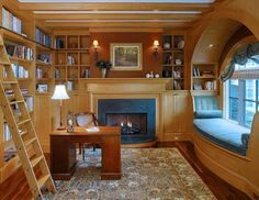 This house has the perfect home office for a book lover! There's a writing desk, wall-to-wall bookshelves, and even a window reading nook! <3