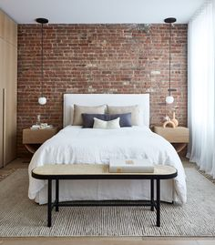 A SoHo loft apartment with exposed brick walls and a neutral color palette with subtle color touches Loft Design, Accent Wall Bedroom, Bedroom Interior, Bedroom Design, Bedroom Wall, Trending Decor, Brick Wall Bedroom, House Interior, Apartment Decor