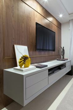 'Would be even more amazing if the TV was built-in/flush-mounted into the wall and wood paneling. Barra Funda II Apartment in São Paulo, Brazil by Kwartet Arquitetura