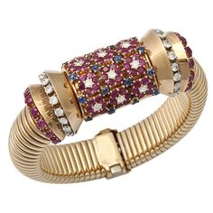 1940's Covered Watch Bracelet 14KT Ruby, Sapphire, Diamond | From a unique collection of vintage wrist watches at https://www.1stdibs.com/jewelry/watches/wrist-watches/