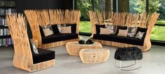 Kenneth Cobonpue : Collections : YODA - The Yoda taps the natural tension of the rattan vine, resembling tall blades of grass growing from the seat on a summer's day. It's rattan display offers comfort concealed in randomness reminiscent of nature's surprises.