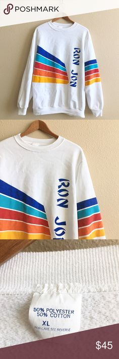 Ron Jon Surf Pullover Pullover crew neck surf sweatshirt with rainbow graphics.  BRAND: Ron Jon MATERIAL: 50/50 YEAR/ERA: late 80s/early 90s LABEL SIZE: XL BEST FIT: M/L  MEASUREMENTS: Chest 22.5 inches  Length 28 inches   I do not model or trade, sorry!  Check out my closet for more vintage! Vintage Tops Sweatshirts & Hoodies