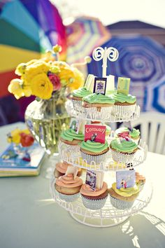 Cupcakes with tiny children's books on them...Adorable!  (make blank mini books out of paper, then print thumbnail-size pictures of classic book covers and glue them on the front)