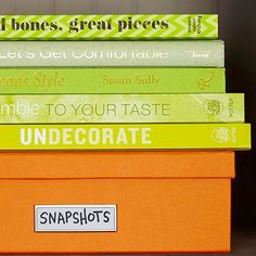 Everyone has lots of stuff that is odd-sized or not that pretty to look at, but simple organizational tricks can help. For starters, covered boxes are a good way to corral items that shouldn't or can't be left loose or those that are awkwardly sized. There's a decor-friendly way to improve your book storage too: Group titles -- no matter their size -- based on the colors of the covers./