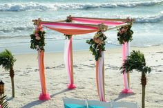"""Fuchsia and Orange make a great """"tropical"""" color combo for a beach wedding.  Photo and Set-up by Sunset Beach Weddings."""