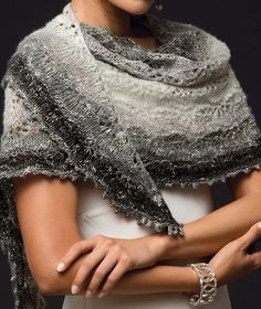 Knitting Pattern for One Skein Snow Flower Shawl - This lace crescent shawl features a snow flower lace patter (a repeat of garter, eyelets and stockinette) and uses one skein of the recommended yarn – 518 yards (474 m) of Aran weight yarn. Designed by by Zabeth Loisel-Weiner. One of the patterns in Vogue Knitting, Holiday 2016