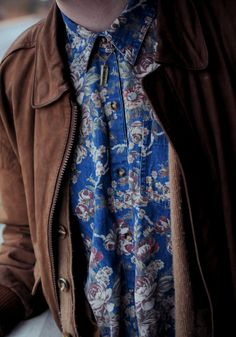 floral shirt and work coat