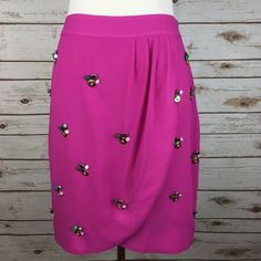 """[Anthropologie] Fei Ballet Notions Skirt Buttons Beautiful pink skirt by Fei from Anthropologie. Draped silken layers with a wrap tulip hem. Clusters of buttons and notions accent the front. Side zip. Lined.  🔹Fabric: Polyester  🔹Waist: 13.5"""" 🔹Length: 20"""" 🔹Condition: EUC. Small X through label as shown to prevent retail returns. No visible flaws.  No Trades! Anthropologie Skirts"""